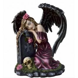Ange déchue pleurant sur une pierre tombale